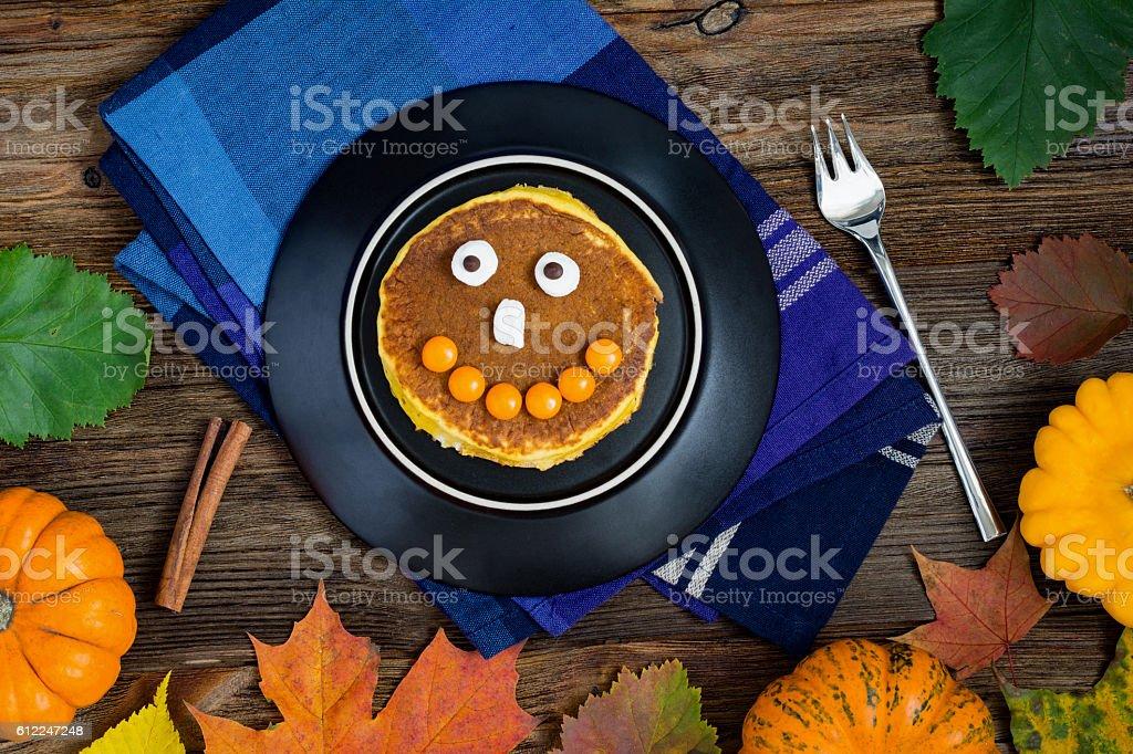 Pumpkin pancakes for Halloween breakfast stock photo