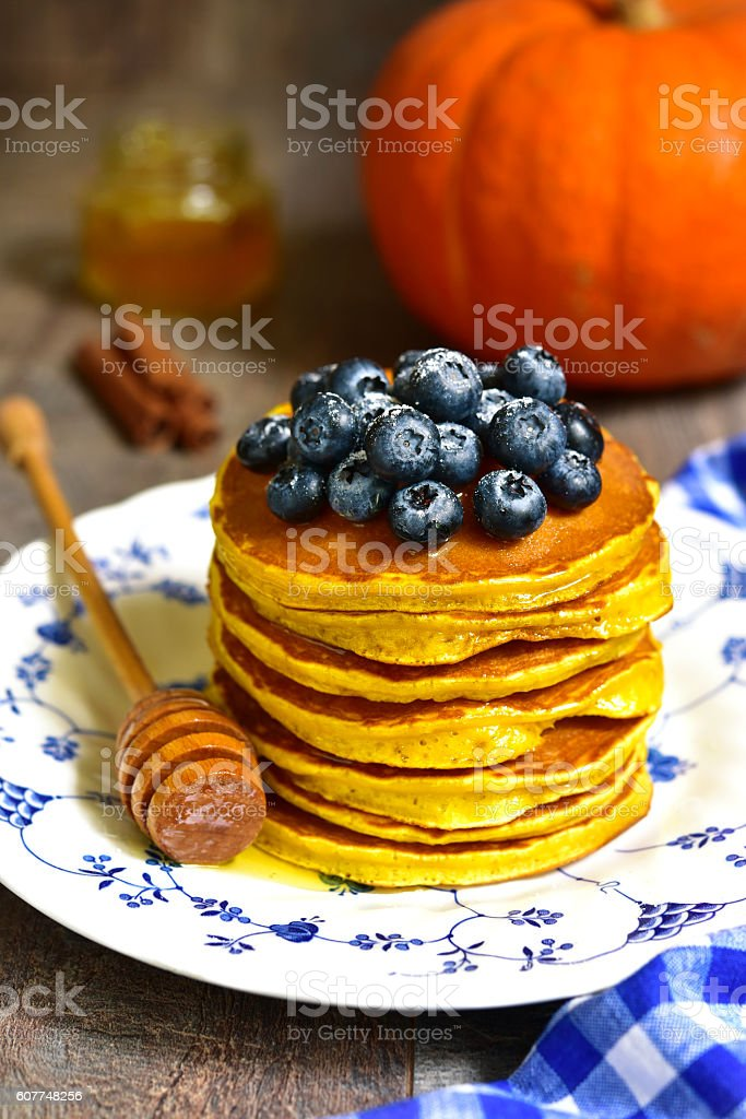Pumpkin pancakes with fresh blueberry and honey. stock photo