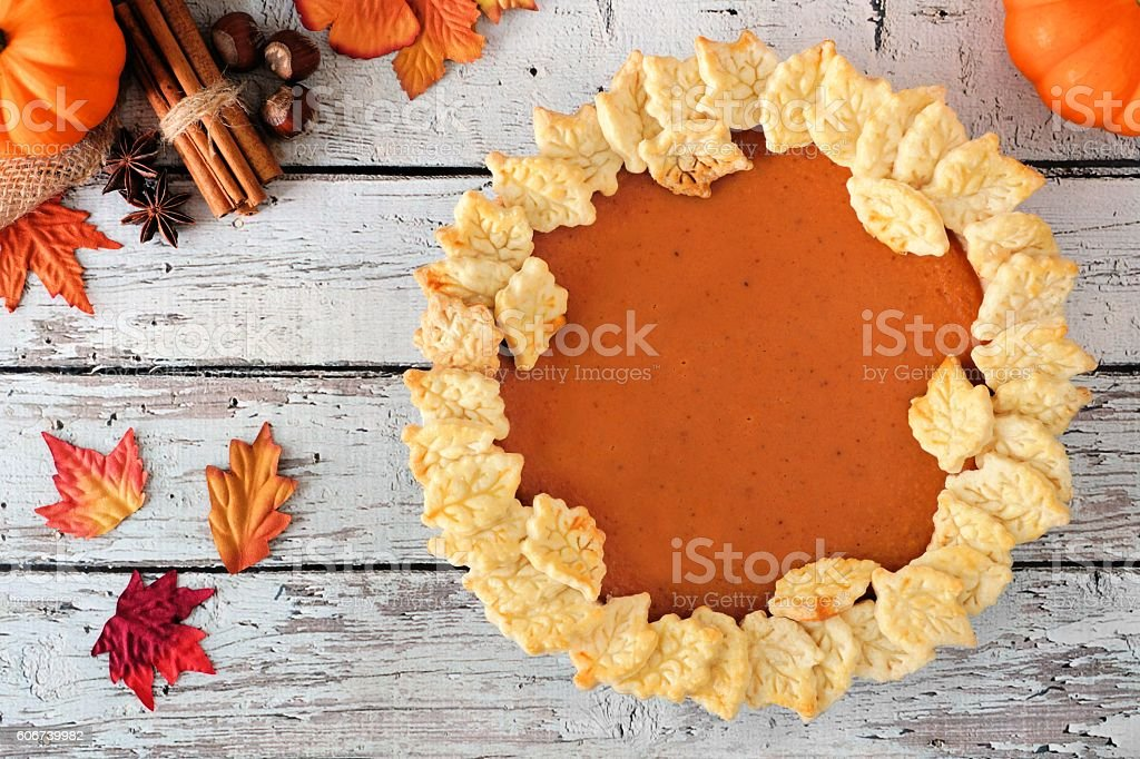 Pumpkin pie above view on white wooden background stock photo