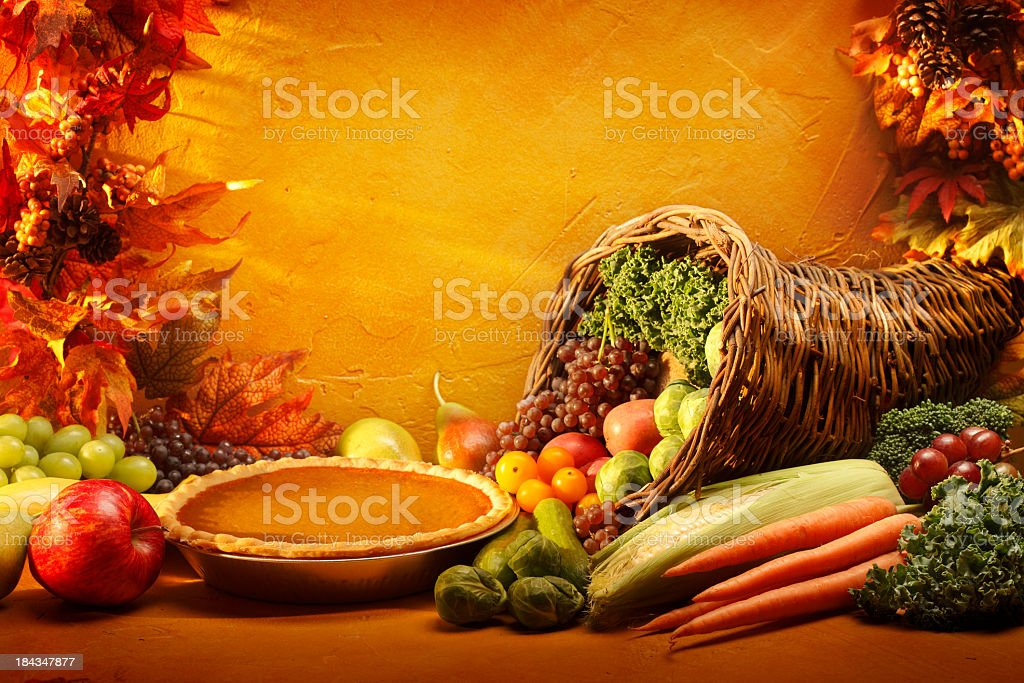 Pumpkin Pie and Cornucopia in an autumn setting stock photo