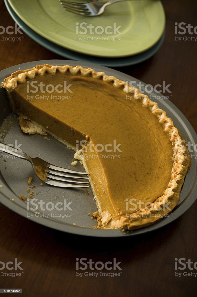 Pumpkin Pie and Plates royalty-free stock photo