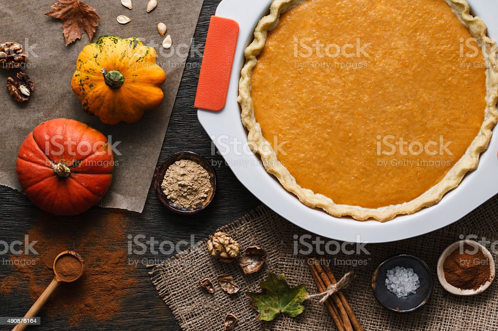 Pumpkin pie cooking process stock photo