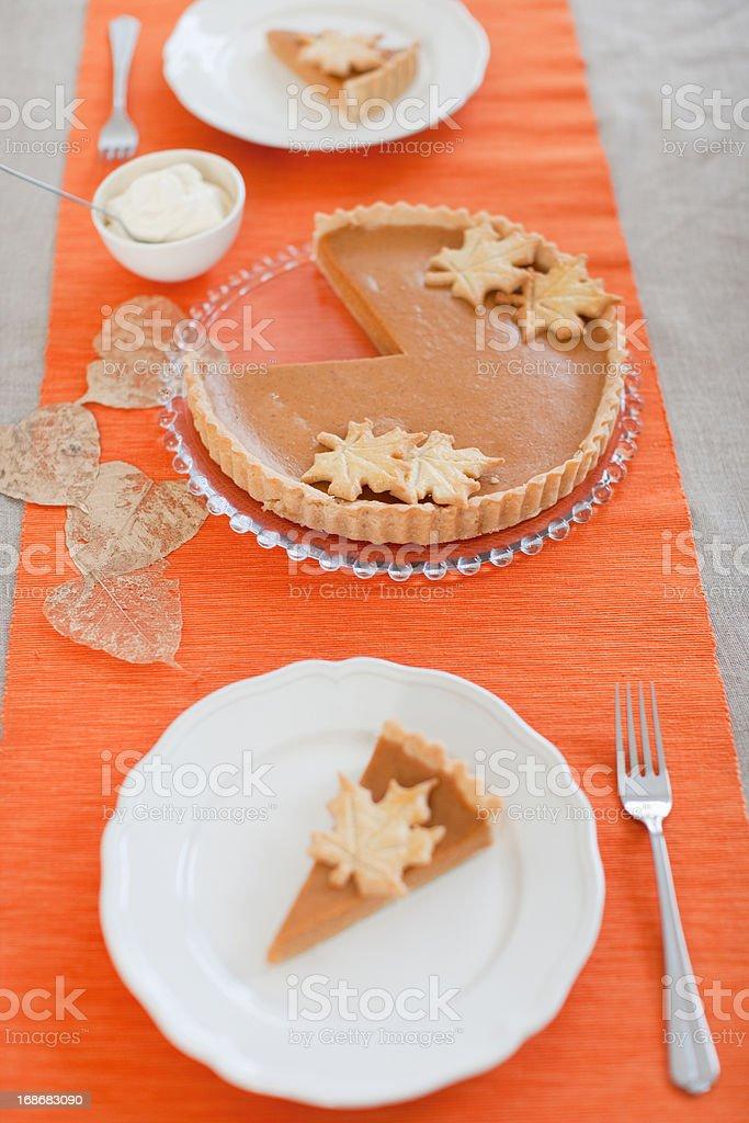 Pumpkin pie on table royalty-free stock photo