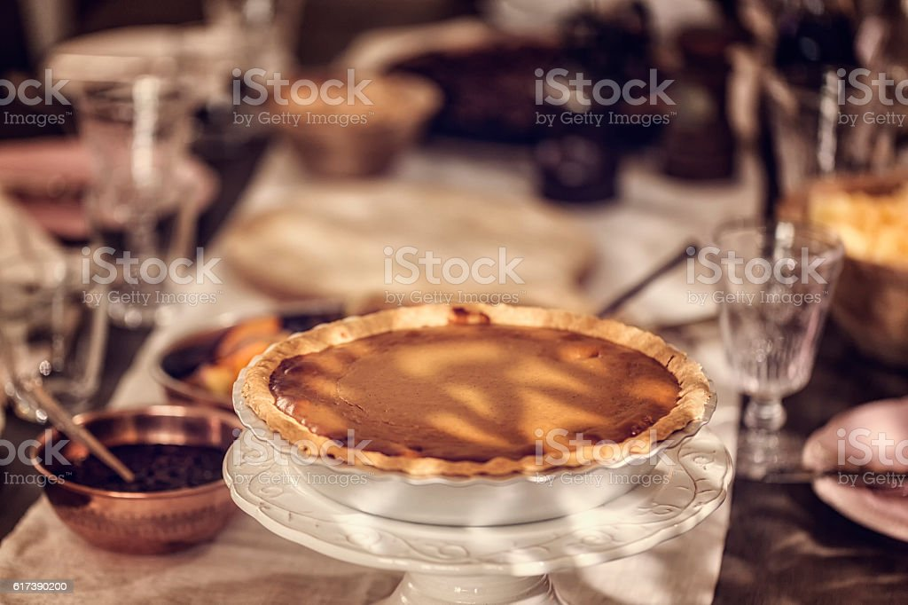 Pumpkin Pie Served for Traditional Holiday Dinner stock photo