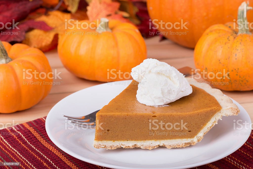 Pumpkin Pie Slice and Pumpkins stock photo