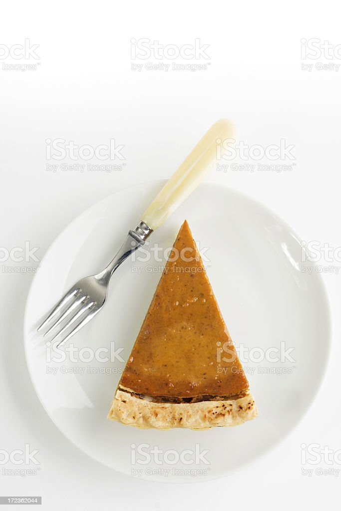 Pumpkin Pie Slice, Thanksgiving Baked Dessert with White Plate, Fork stock photo
