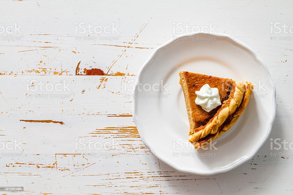 Pumpkin pie, white wood background stock photo