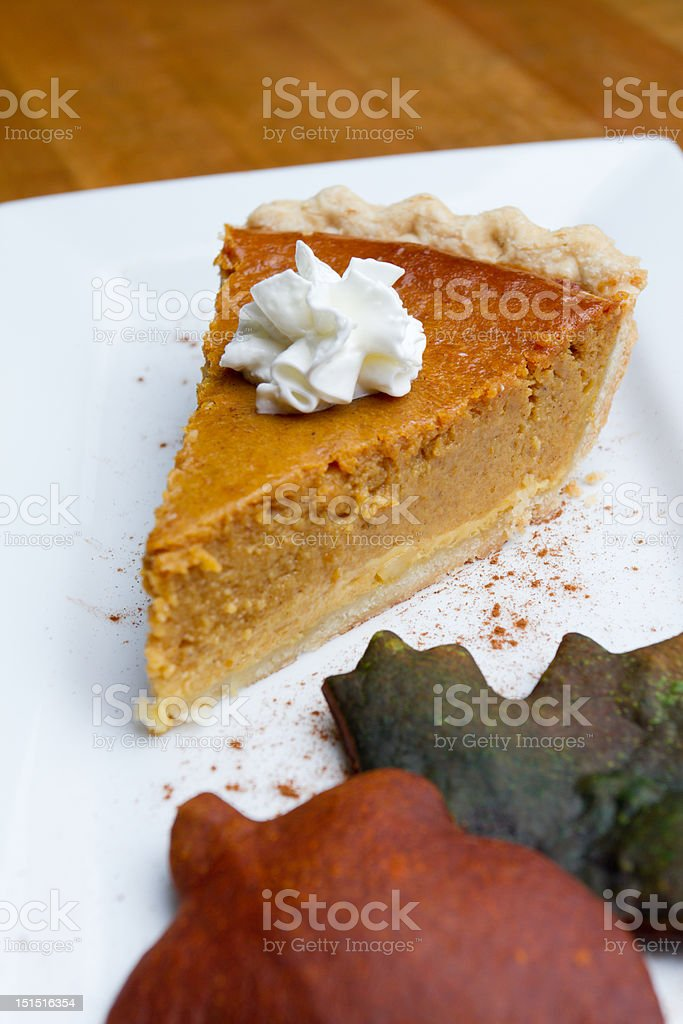 Pumpkin Pie with Autumn Leaves royalty-free stock photo
