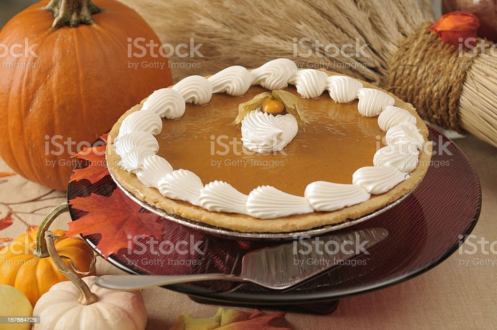 Pumpkin pie with cream icing on a cake stand royalty-free stock photo