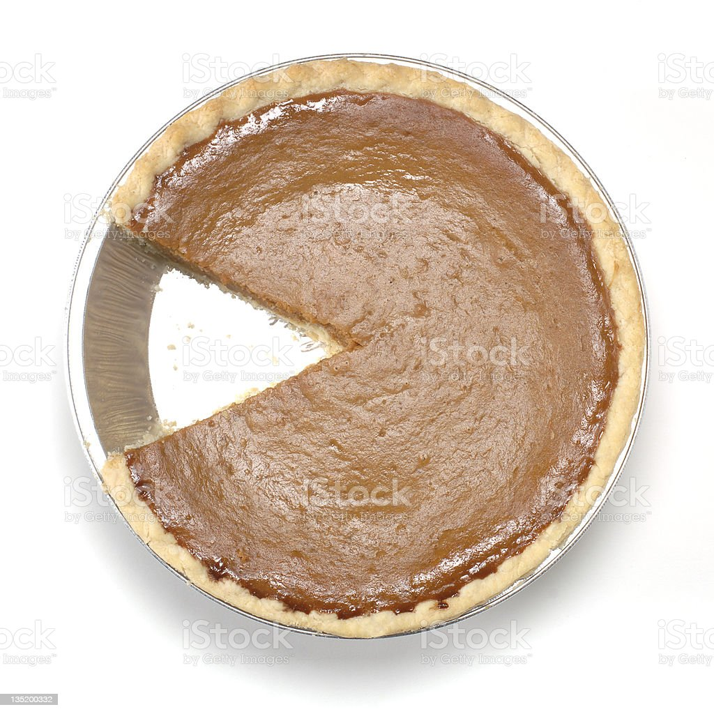 A pumpkin pie with one slice missing on the white background stock photo
