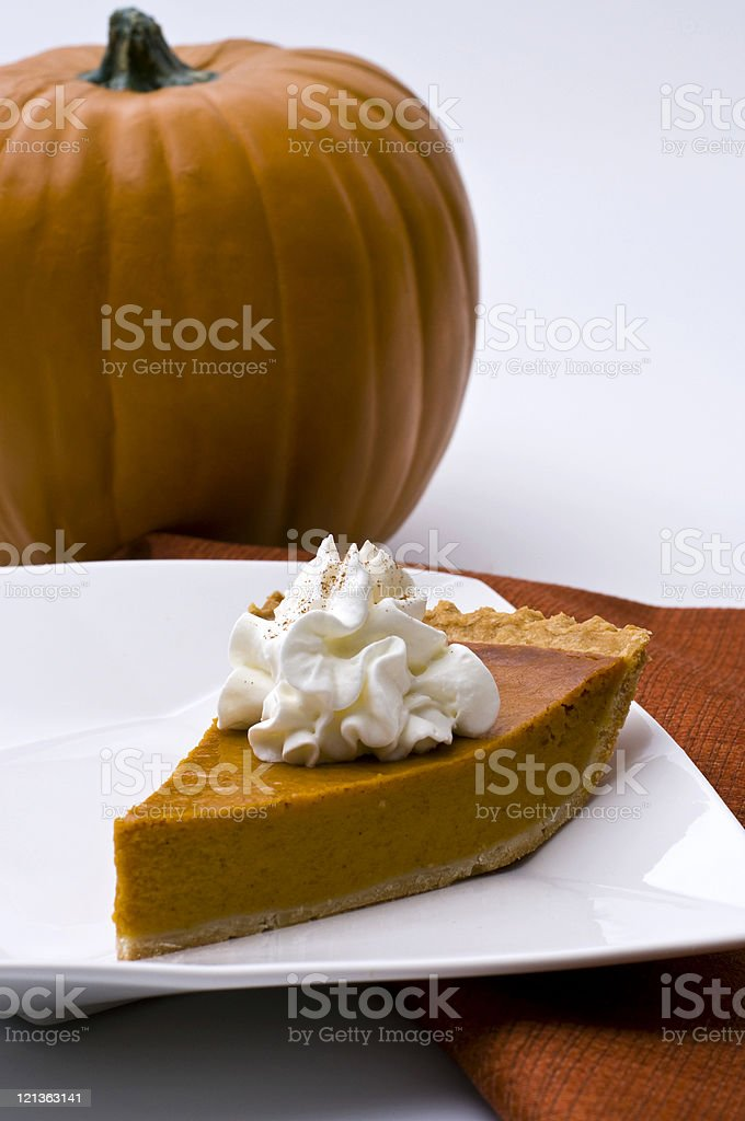 Pumpkin Pie with topping royalty-free stock photo