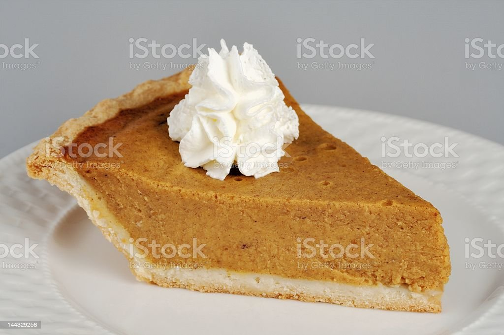 Pumpkin Pie with Whipped Cream royalty-free stock photo