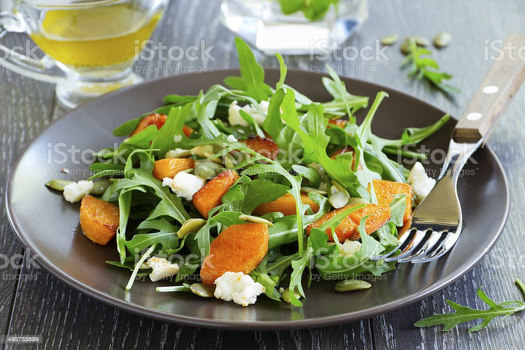 Pumpkin salad, arugula and feta. stock photo