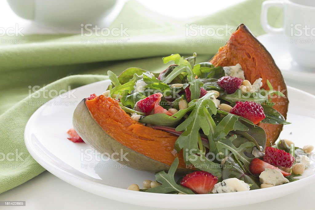 Pumpkin salad with arugula and cheese. royalty-free stock photo