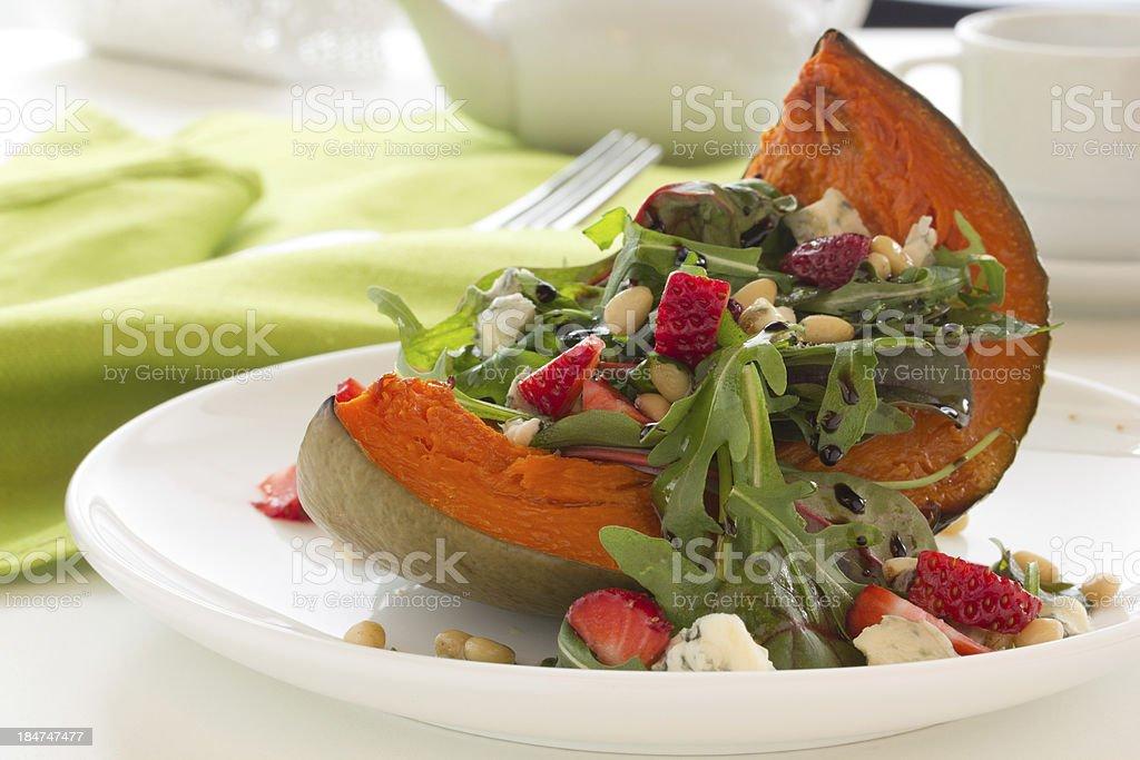 Pumpkin salad with arugula and cheese. royalty-free stock photo