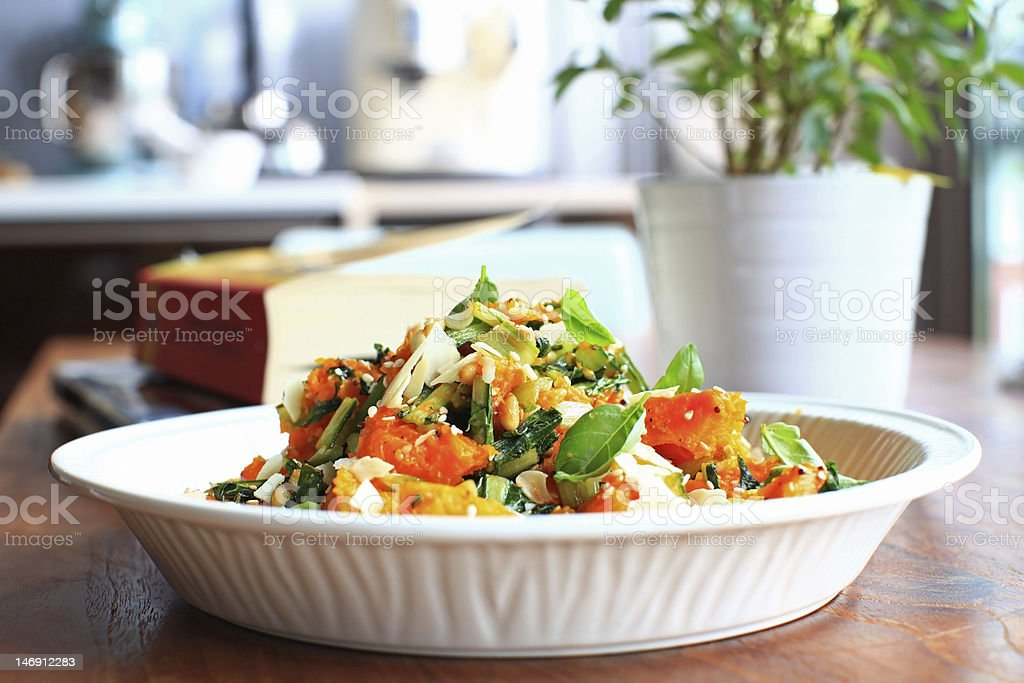 Pumpkin salad with basil and nuts royalty-free stock photo