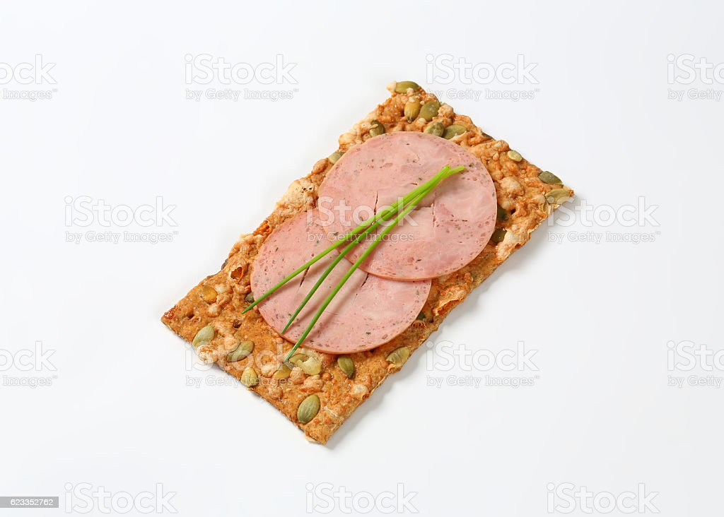 pumpkin seed cracker with soft sausage slices stock photo