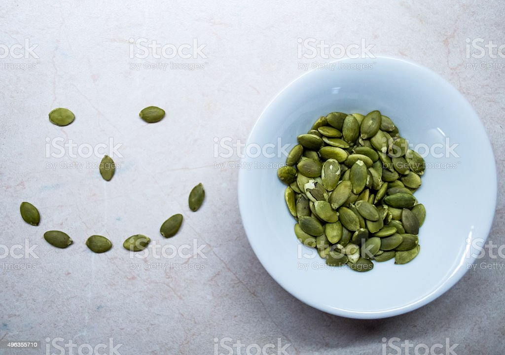 Pumpkin Seeds in a Bowl and a Smiley/Happy Face royalty-free stock photo