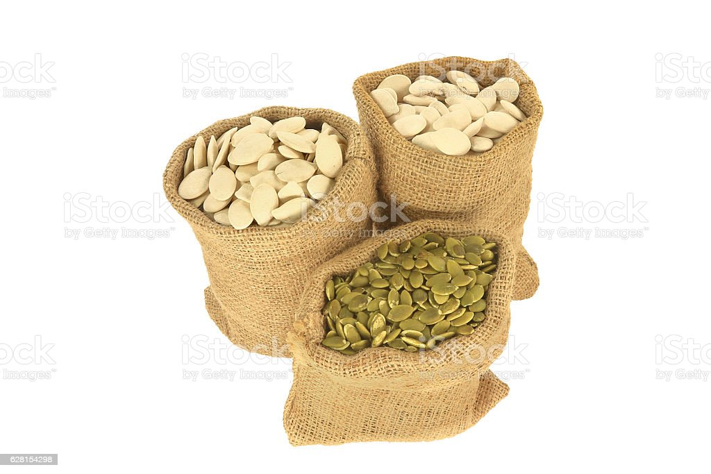 Pumpkin seeds with and without shell stock photo