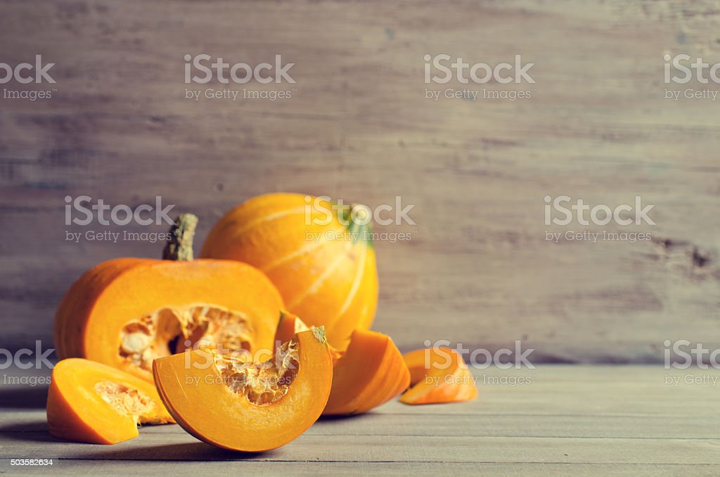 Pumpkin slices with seeds stock photo