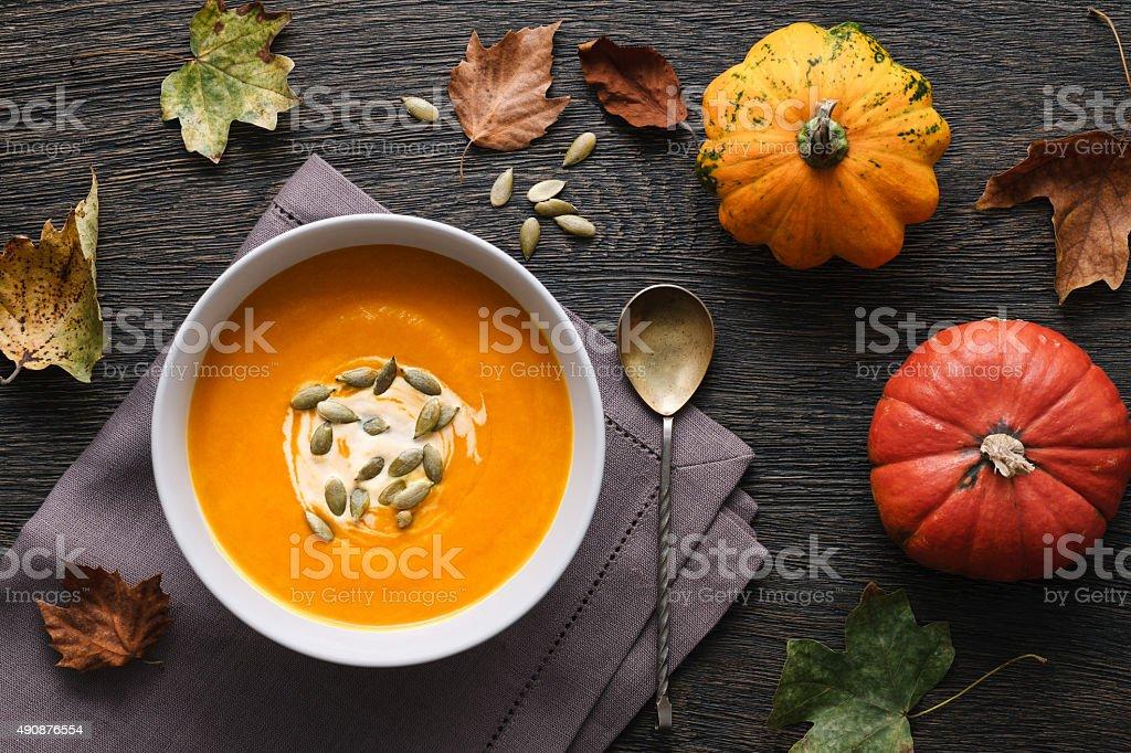 Pumpkin soup among the leaves stock photo