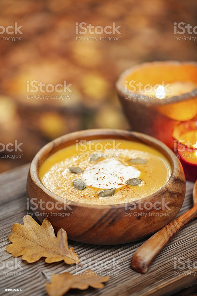 Pumpkin soup in a rustic bowl outside royalty-free stock photo