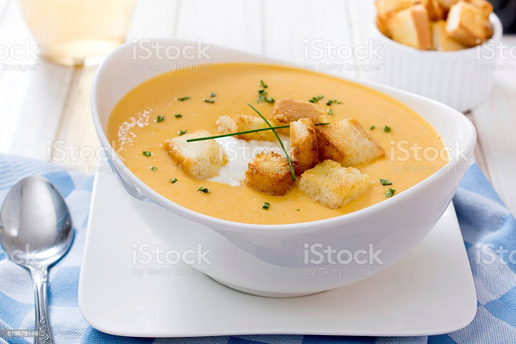 Pumpkin soup in bowl stock photo