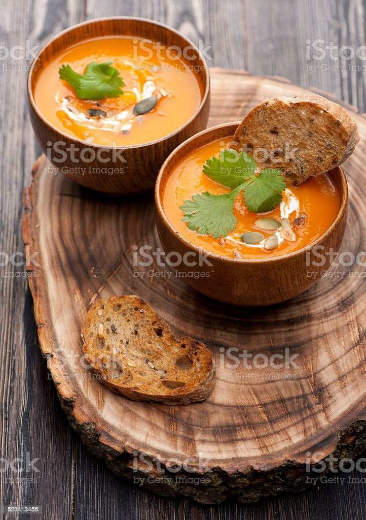 Pumpkin soup in rustic style stock photo