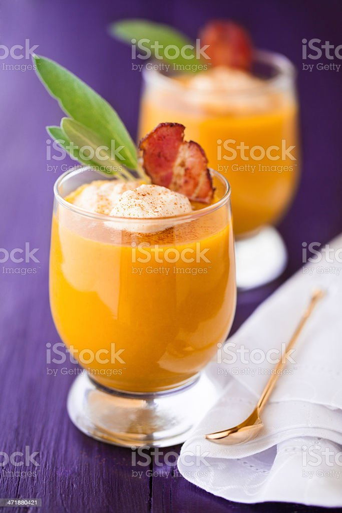 Pumpkin soup served in glasses stock photo