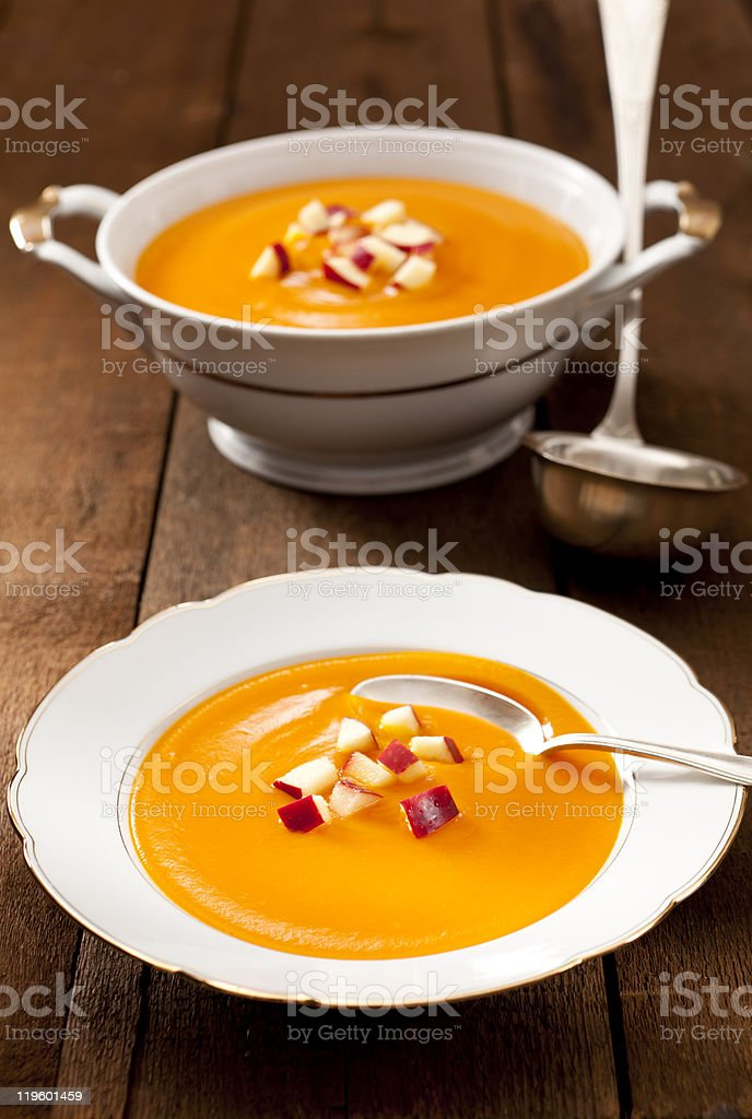 Pumpkin soup served in white porcelain stock photo