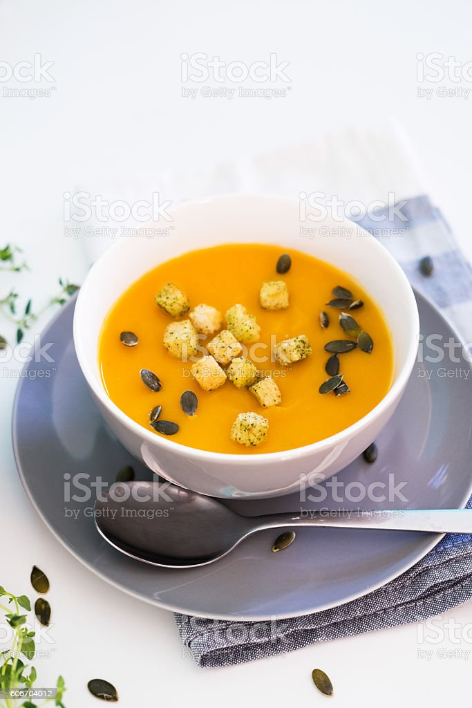 Pumpkin soup served with croutons and pumpkin seeds stock photo