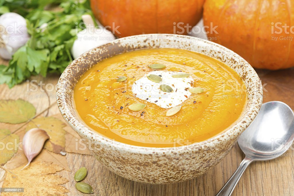 pumpkin soup with coriander in a bowl royalty-free stock photo