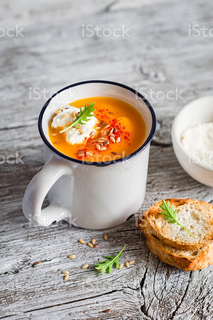 pumpkin soup with paprika in ceramic mug stock photo