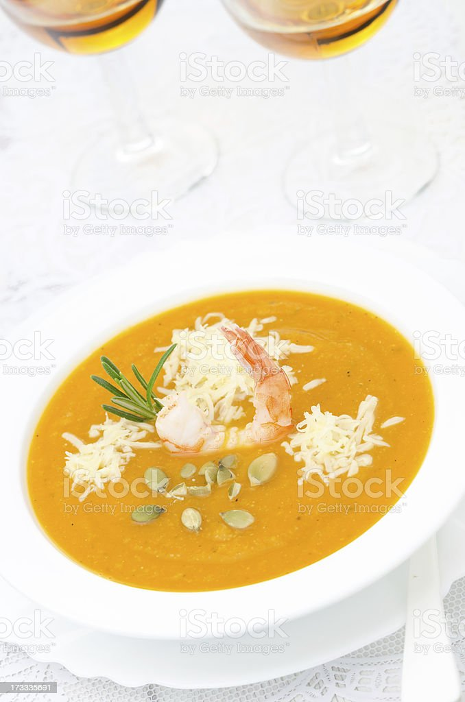pumpkin soup with shrimp, Parmesan and rosemary royalty-free stock photo