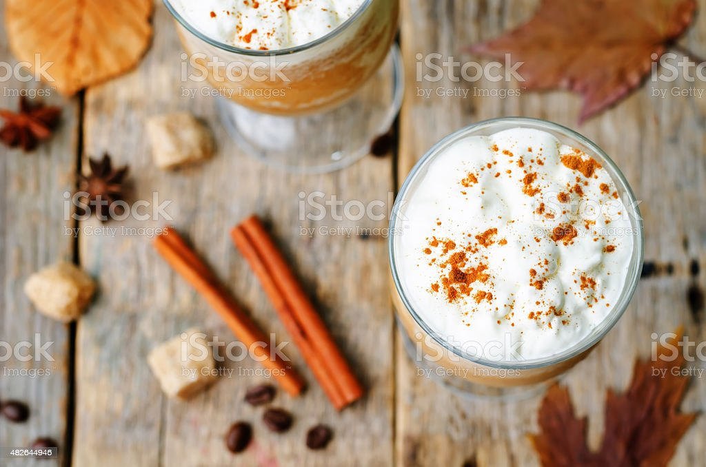 pumpkin spice frappuccino with whipped cream stock photo