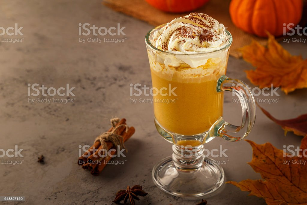 Pumpkin spice latte with whipped cream. stock photo