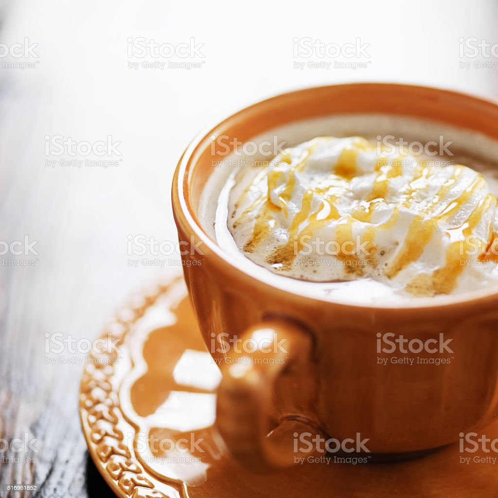 pumpkin spiced latte coffee drink with caramel and cream stock photo