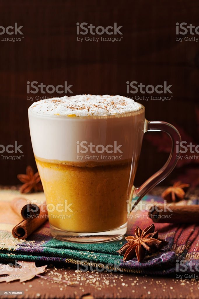 Pumpkin spiced latte or coffee. Autumn or winter hot drink. stock photo
