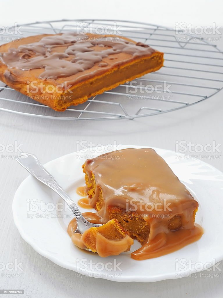 Pumpkin sticky pudding with toffee caramel sauce stock photo