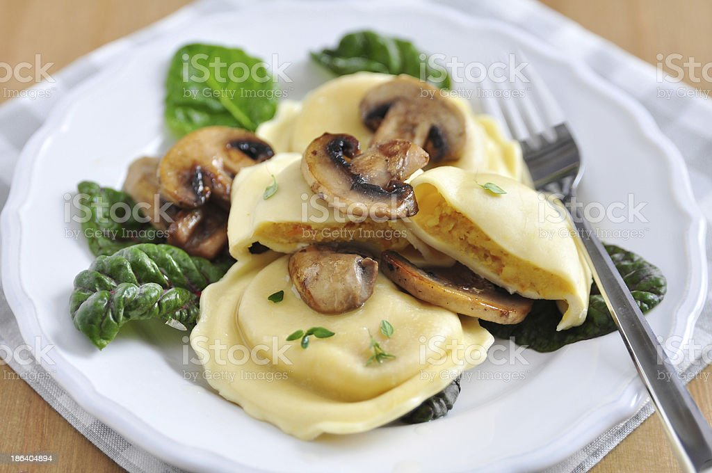 Pumpkin Tortellini with chard and mushrooms stock photo