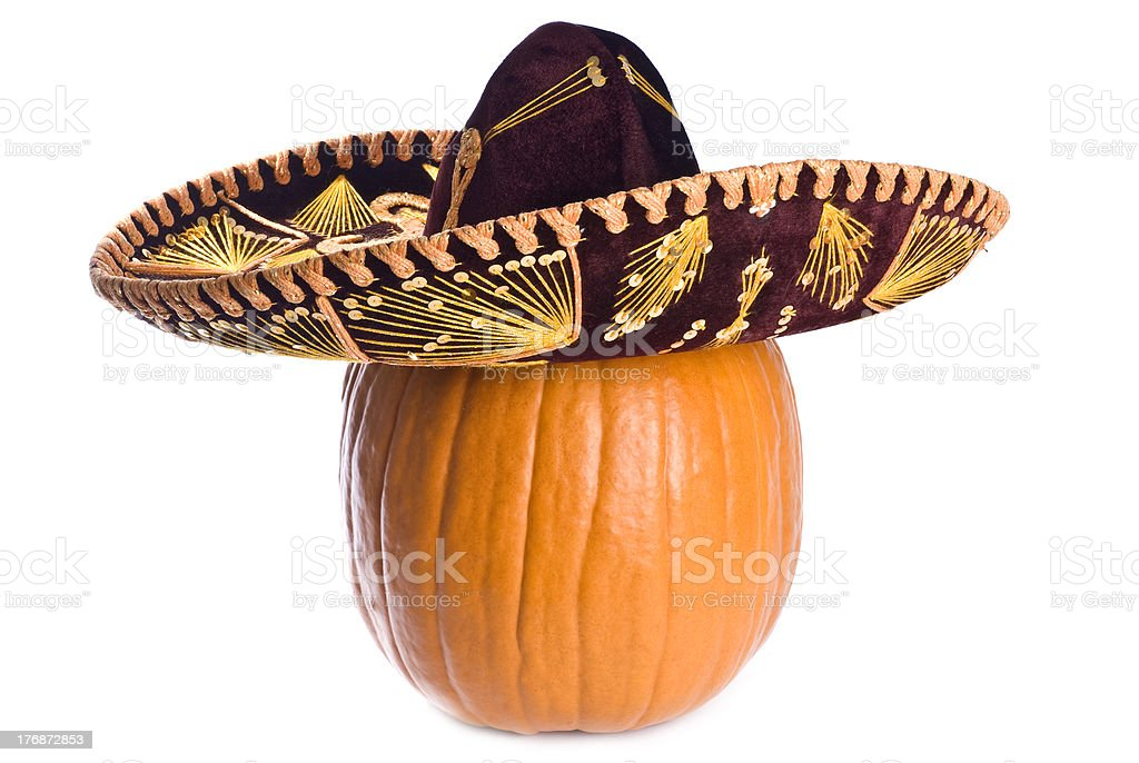 Pumpkin Wearing a Mexican Sombrero Isolated on White stock photo