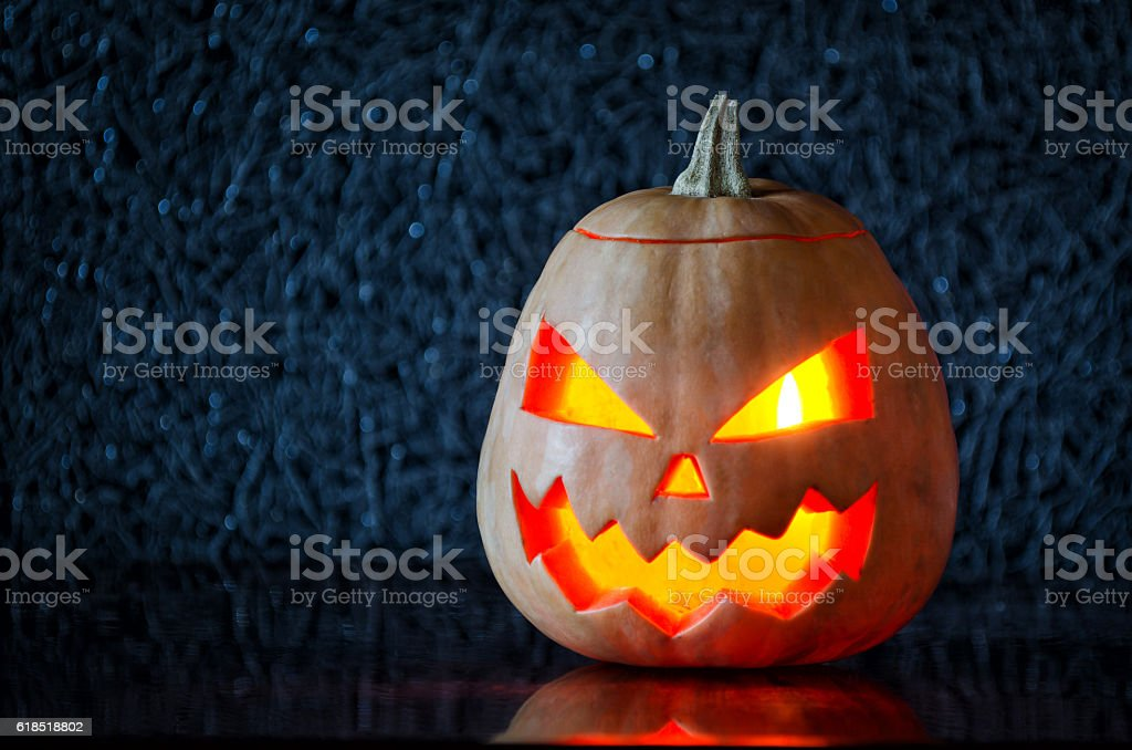 Pumpkin with a candle on Halloween. stock photo