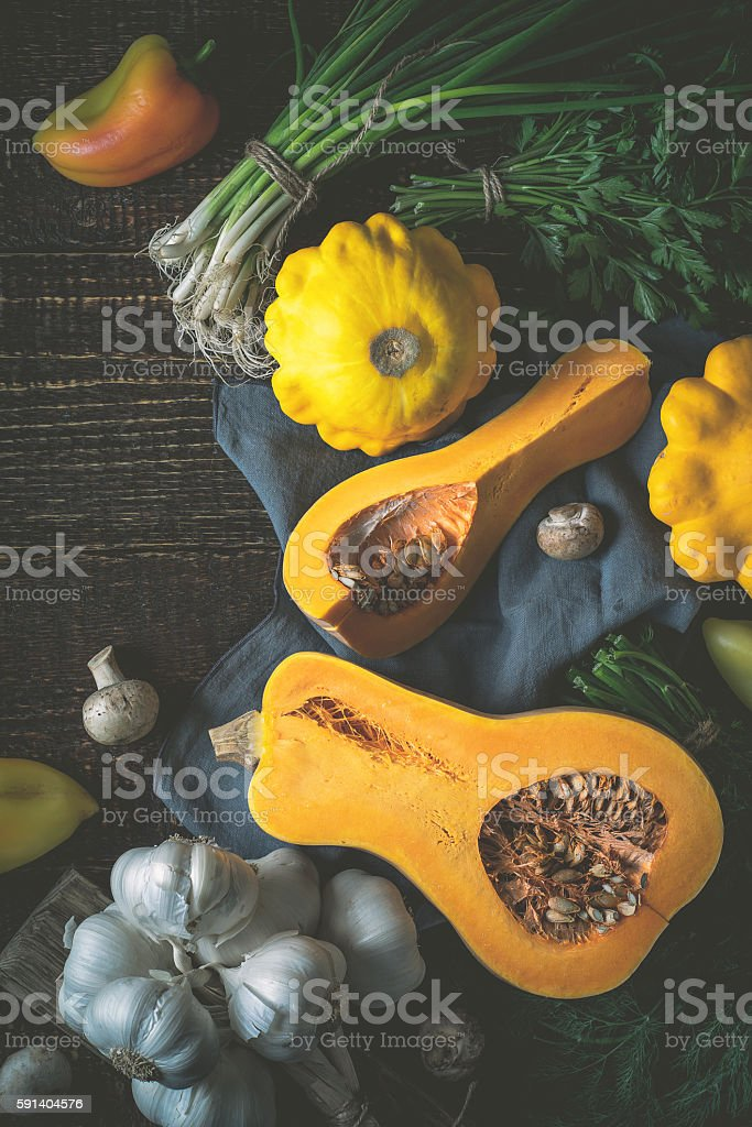 Pumpkin with different vegetables on  wooden table  top view vertical stock photo