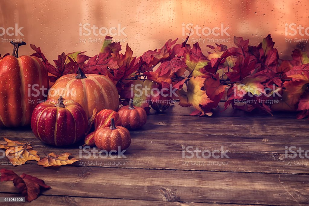 Pumpkins and Autumn Leafs on Wooden Background stock photo