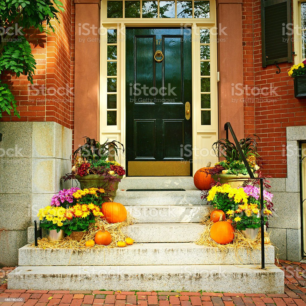 Pumpkins near the door for Halloween stock photo