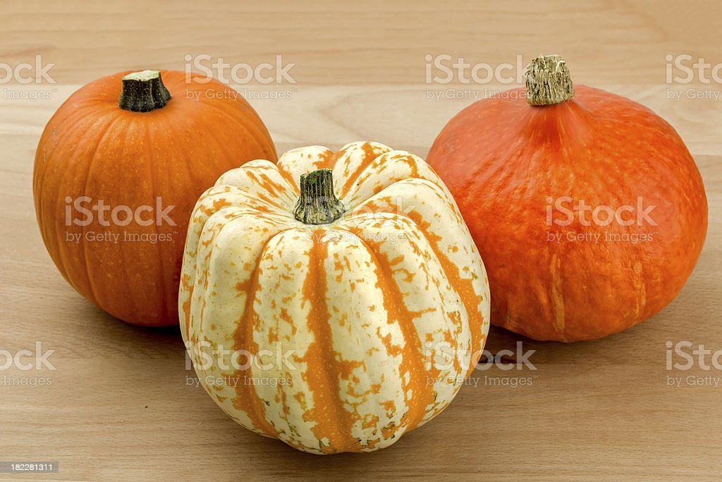 Pumpkins on a Wooden Cutting Board stock photo