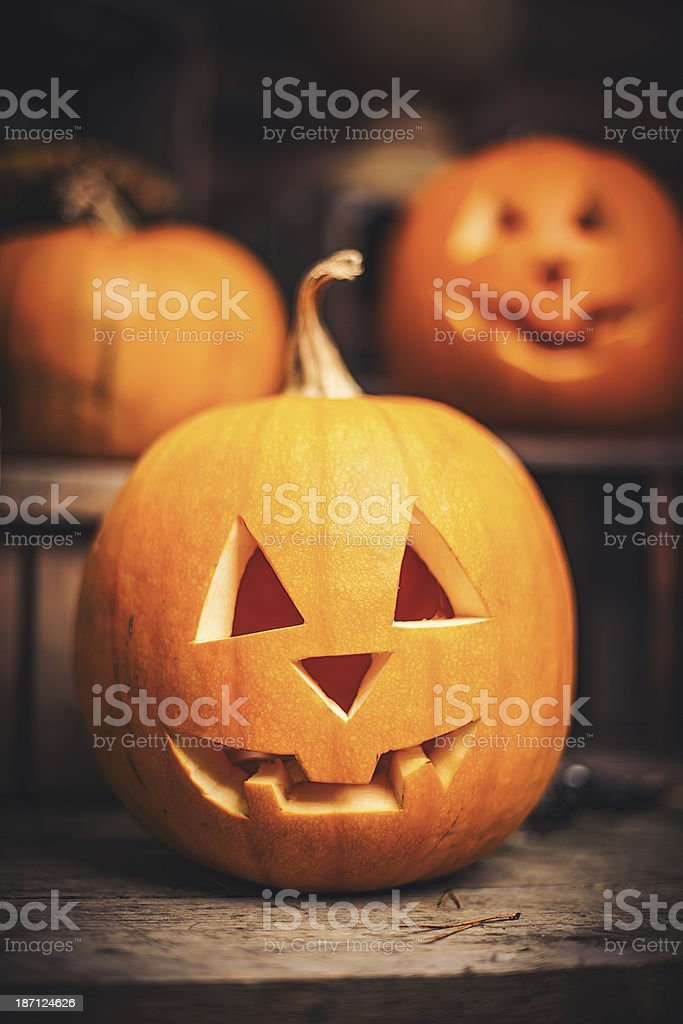 Pumpkins on front step with halloween decorations royalty-free stock photo