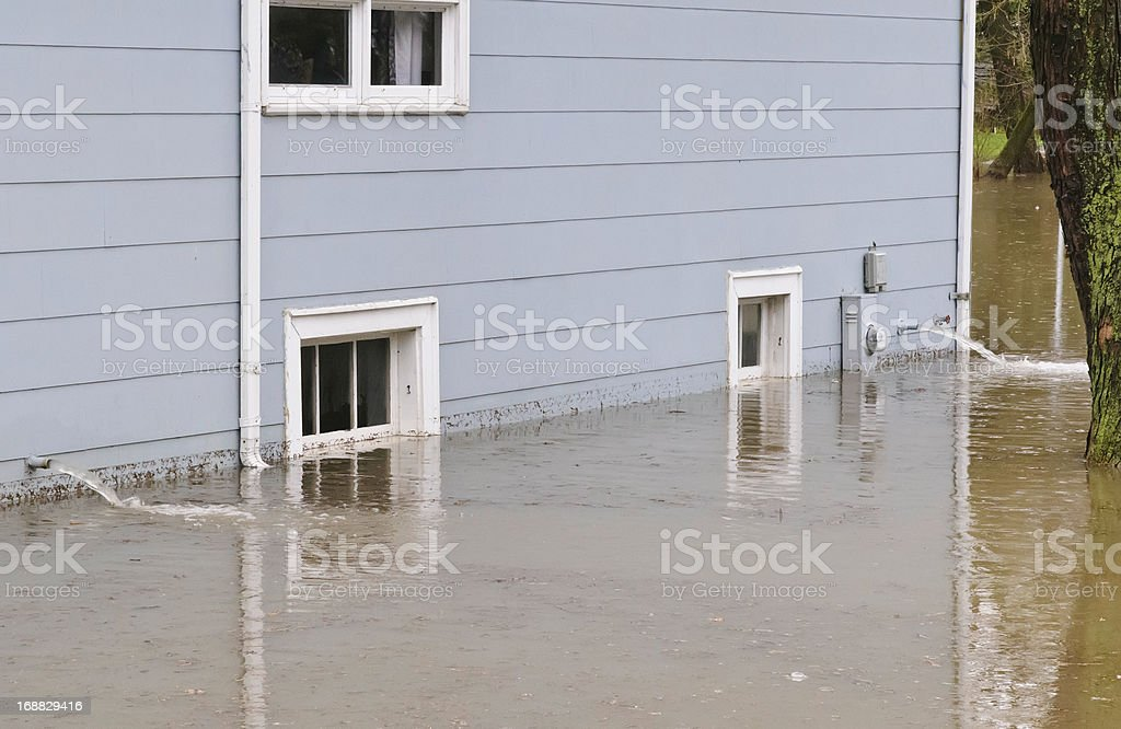 Pumpout in flood after spring storms stock photo