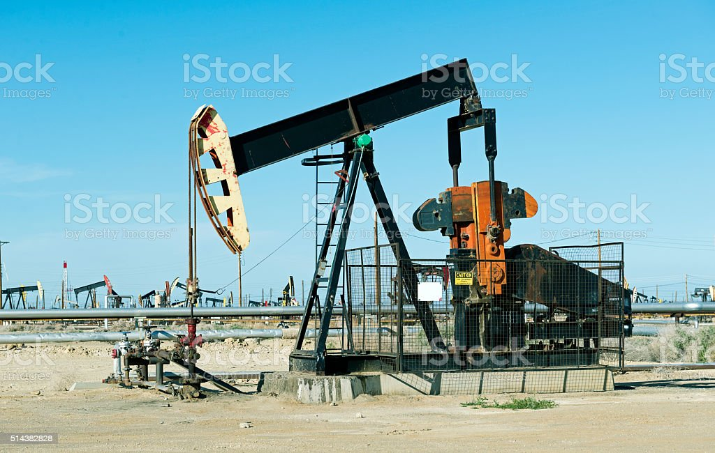 Pumps and pipes at oil field in central California stock photo
