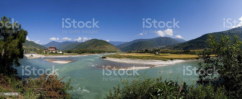 Punakha Dzong and the Mo Chhu river in Bhutan stock photo
